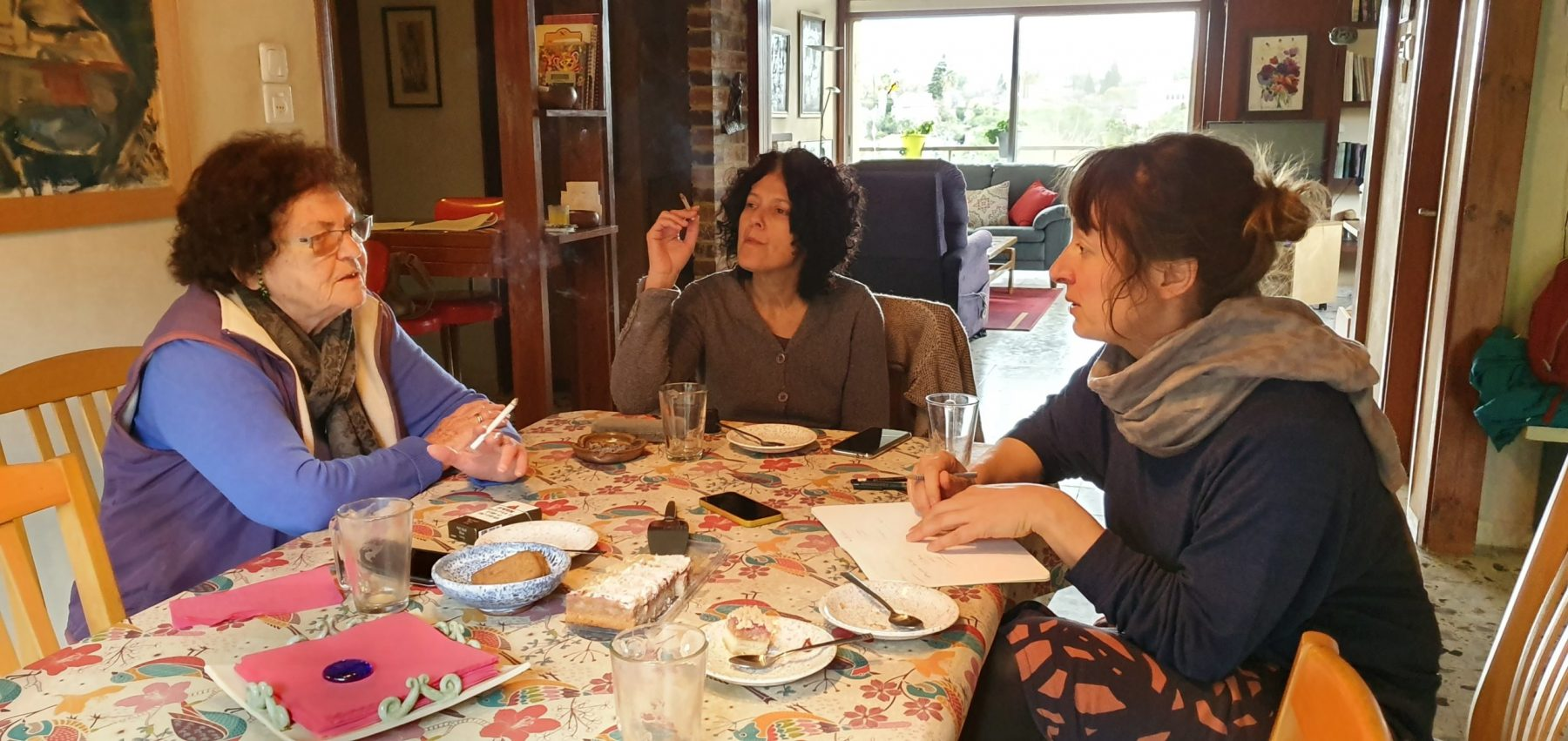 Barbara, Emmie, and Orli around the table